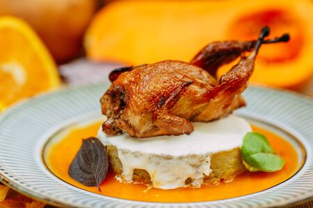 Autumn table setting with pumpkins. Thanksgiving dinner.Hosper Chicken with BBQ Sauce