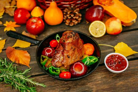 Autumn table setting with pumpkins. Thanksgiving dinner.baked pork shank with vegetables