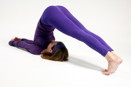 Halasana or the Plow Pose in yoga photo