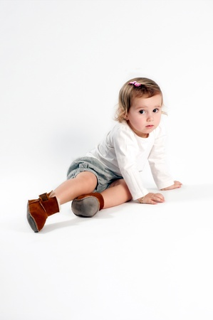 Young girl sitting on the floor in studion Stock Photo - 13770873