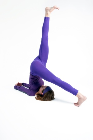 Eka Pada Sarvangasana or One Legged Shoulderstand in yoga photo