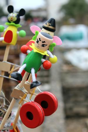 wood craft: Cartoon Doll Toy Stock Photo