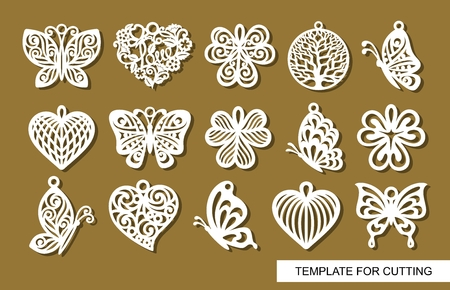 Set of decorative pendants. Decor in shape openwork butterflies, clover leaves, round hearts and lace hearts. Template for laser cutting, wood carving, paper cut or printing. 写真素材 - 119150769