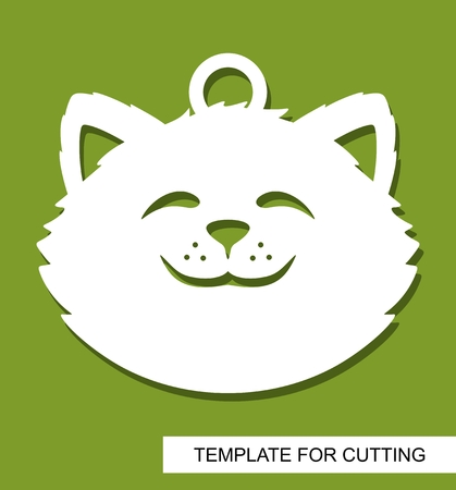 Cat head silhouette. Hanging toy or pendant. White cartoon character on a green background. Template for laser cutting, wood carving, paper cut or printing. Vector illustration.
