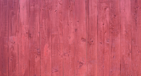 Natural wooden background. Surface of wooden texture for design and decoration. Shabby vertical boards with peeling paint . Crimson color. Copy space.
