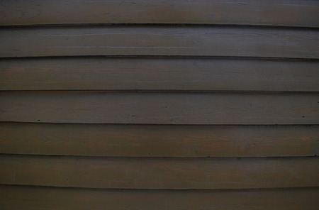 Wooden background. Surface of wooden texture for design and decoration. Horizontal stripes (planks). Dark brown color.