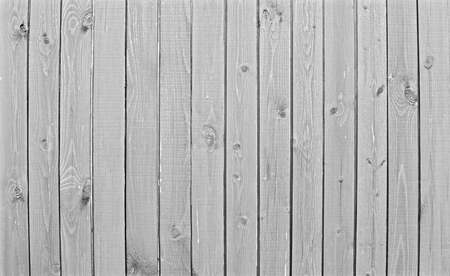 Natural wooden background. Surface of wooden texture for design and decoration. Shabby vertical boards with peeling paint. Gray color. Copy space.