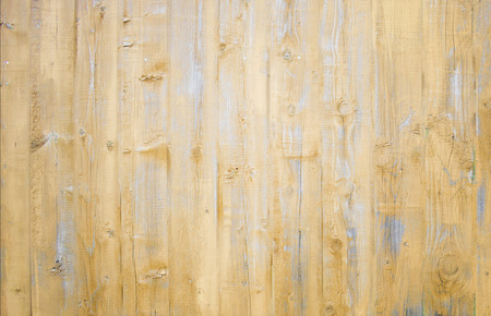 Natural wooden background. Surface of wooden texture for design and decoration. Shabby vertical boards with peeling paint. Light brown and gray color. Copy space.
