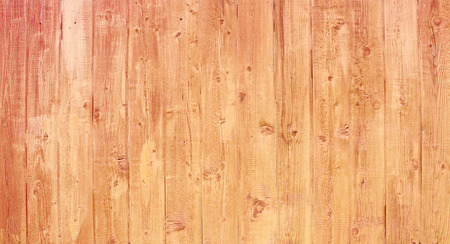 Natural wooden background. Surface of wooden texture for design and decoration. Shabby vertical boards with peeling paint. Brown with a pink shade. Copy space. Foto de archivo - 126955959