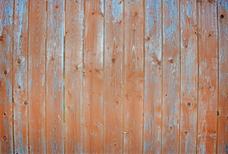 Natural wooden background. Surface of wooden texture for design and decoration. Shabby vertical boards with peeling paint. Brown color. Copy space.