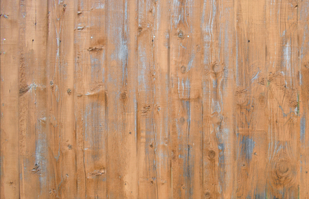 Natural wooden background. Surface of wooden texture for design and decoration. Shabby vertical boards with peeling paint. Brown and gray color. Copy space.