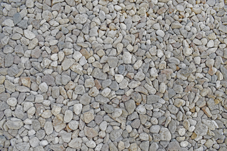 Light grey small pebble. Stones texture. Natural background. Dry gravel.