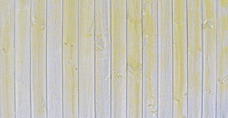 Natural wooden background. Surface of wooden texture for design and decoration. Shabby vertical boards with peeling paint. Gray and yellow color. Copy space. Stock Photo