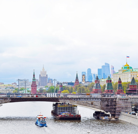 Moscow, Russia - may 2, 2019. Panoramic view of the city center: river, bridge, Kremlin, St. Basils Cathedral, ancient temples and modern skyscrapers. Copy space.