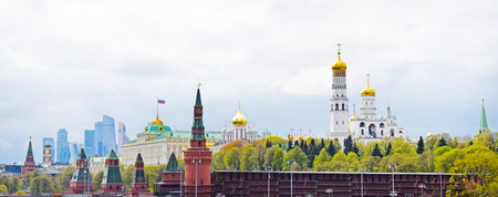 Moscow, Russia - May 2, 2019. Panoramic view of the city center: the Kremlin towers, the Grand Kremlin Palace, Ivan the Great Bell Tower and modern skyscrapers. Copy space.
