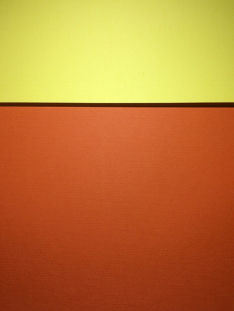 two and two thirds: Two colors tone textured papers abstract background with copy space. Orange and yellow version. Rule of thirds used.
