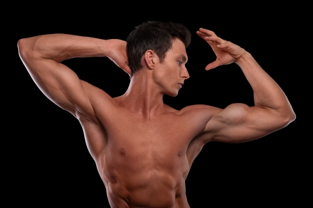 strong arm: Portrait of young male fitness model posing