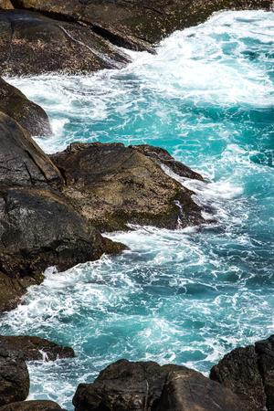 Hainan, Wuzhizhou Island sea waves hitting the rocks