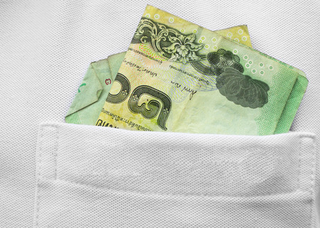 corruptible: Banknote thai baht in shirts pocket,Thailand money. Stock Photo