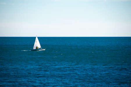 A sailing boat sails on the sea