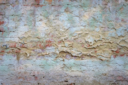 remnants: background texture old brick wall with remnants of colored plasters