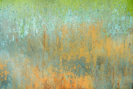 texture of old rusty shabby background with scratches, with the remains of green and blue paint
