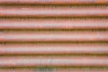 steel sheet: horizontal wavy background texture of old rusty corrugated metal sheet