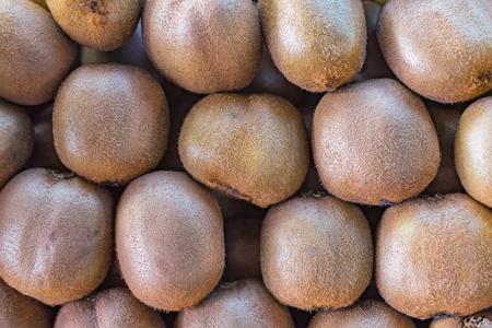 background texture of the folded kiwi fruit on the market counter