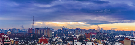 rays of the sun make their way through dramatic clouds over the city of Ivano-Frankivsk, Ukraine