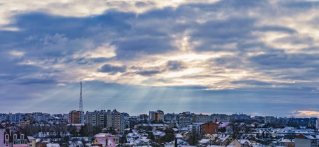 Rays of the sun make their way through dramatic clouds over the city of Ivano-Frankivsk, Ukraine Stok Fotoğraf