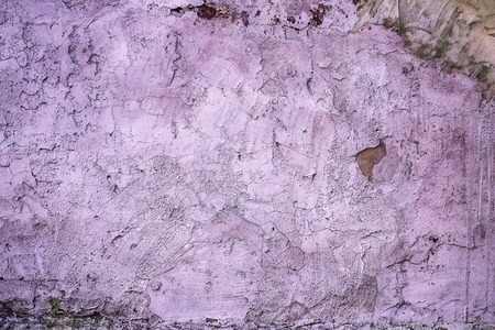 Grunge wall of the old house. Textured background. Plaster hue Ultra Violet