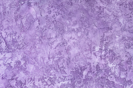 Plaster hue Ultra Violet. Textured background. Wall of the house.
