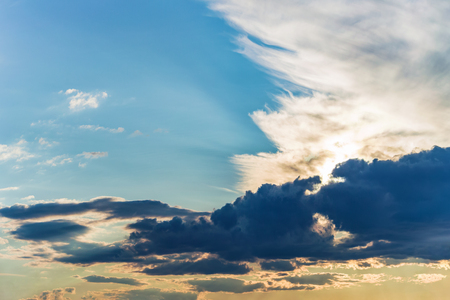 sky background, rays of the sun make their way through dramatic clouds Stok Fotoğraf