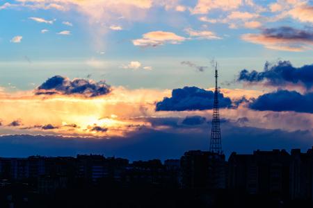 gold sunrise and dramatic sky over the city of Ivano-Frankivsk, Ukraine