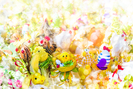 Blurred Easter background with bokeh effect. Chickens, eggs, bunnies and other Easter decorations.