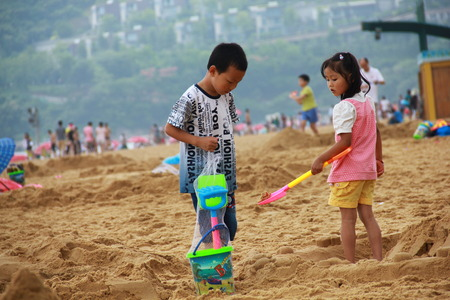 innocence: innocence children playing on beach
