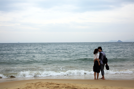 vows: couple at beach