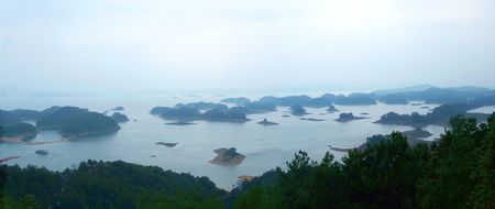 China Qiandao Lake is located in Chunan County is one of national famous scenic spot. Lakes area of 573 square km, the lake has a size of 1078 islands, Qiandao Lake lake open, 1-bi 10000 ares, very beautiful natural scenery. Stock Photo