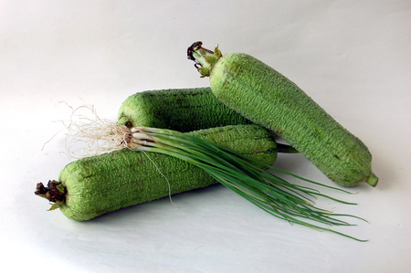 spring onions: Towel gourd and spring Onions Stock Photo