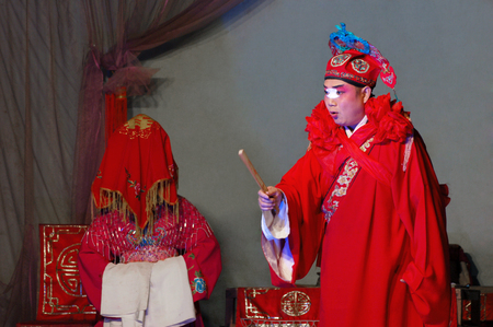 customs official: Chinese opera performance
