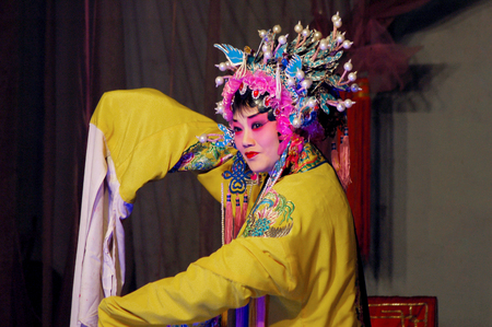 folk customs: Chinese drama - hit the golden bough Editorial
