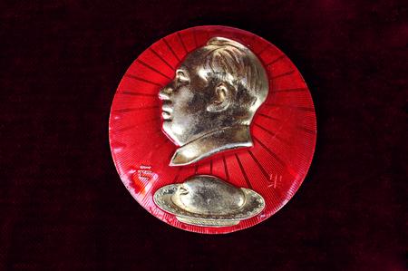 mao: MAO zedong badge with sb on it