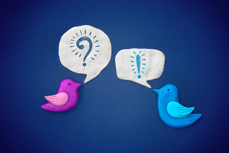 exclamation: Birds symbol carry on dialog with each other. Plasticine illustration. Stock Photo