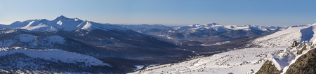 Winter mountain landscape overlooking the of the forest valley. Panoramic photo. Stock Photo