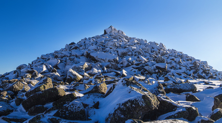 Photo of the mountain top in winter with snow and stones 写真素材