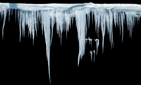 Icicles on an black background, isolated object.