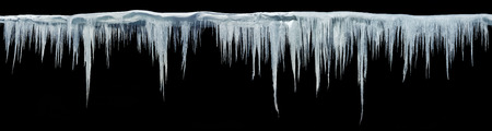 Icicles on an isolated background. Panoramic photo. Stock Photo