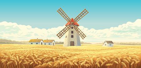 Paysage rural d'automne avec moulin à vent et champs de blé.