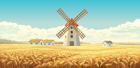 Rural autumn landscape with windmill and wheat fields.