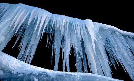 Icicles on an isolated background. Stock Photo